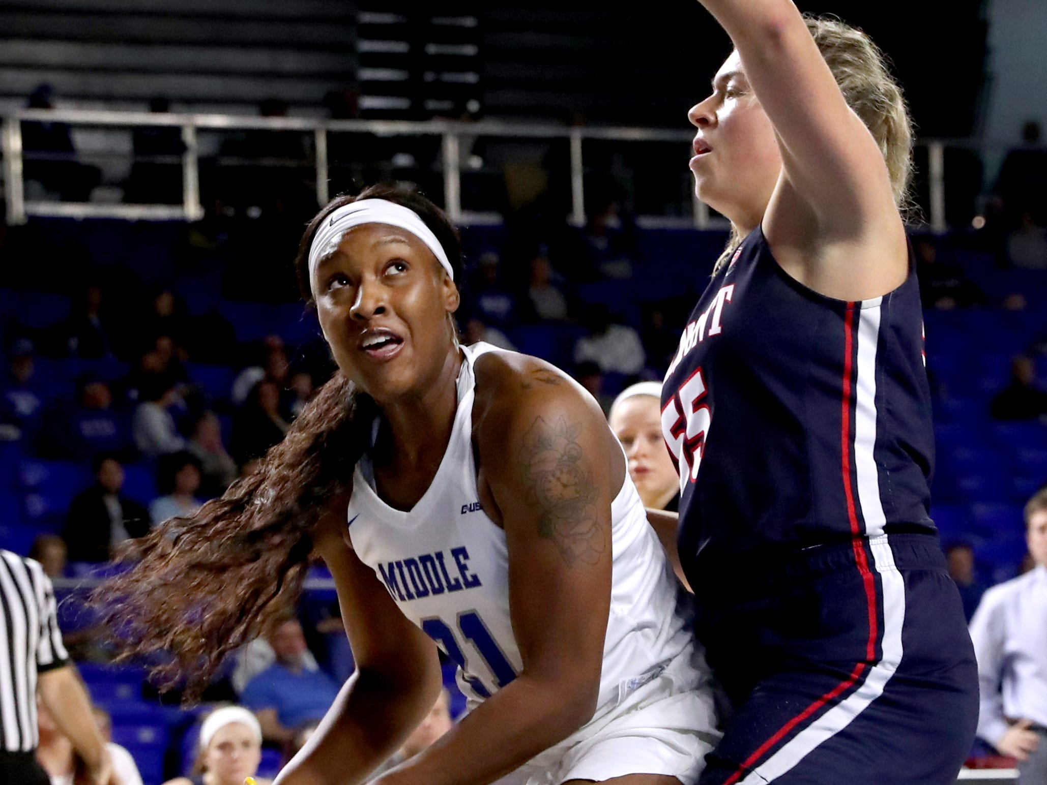 MTSU's LaSonja Edwards (21) goes up for a basket as Belmont's Maddie Wright (55) guards her during the game at MTSU on Monday, Nov. 19, 2018.