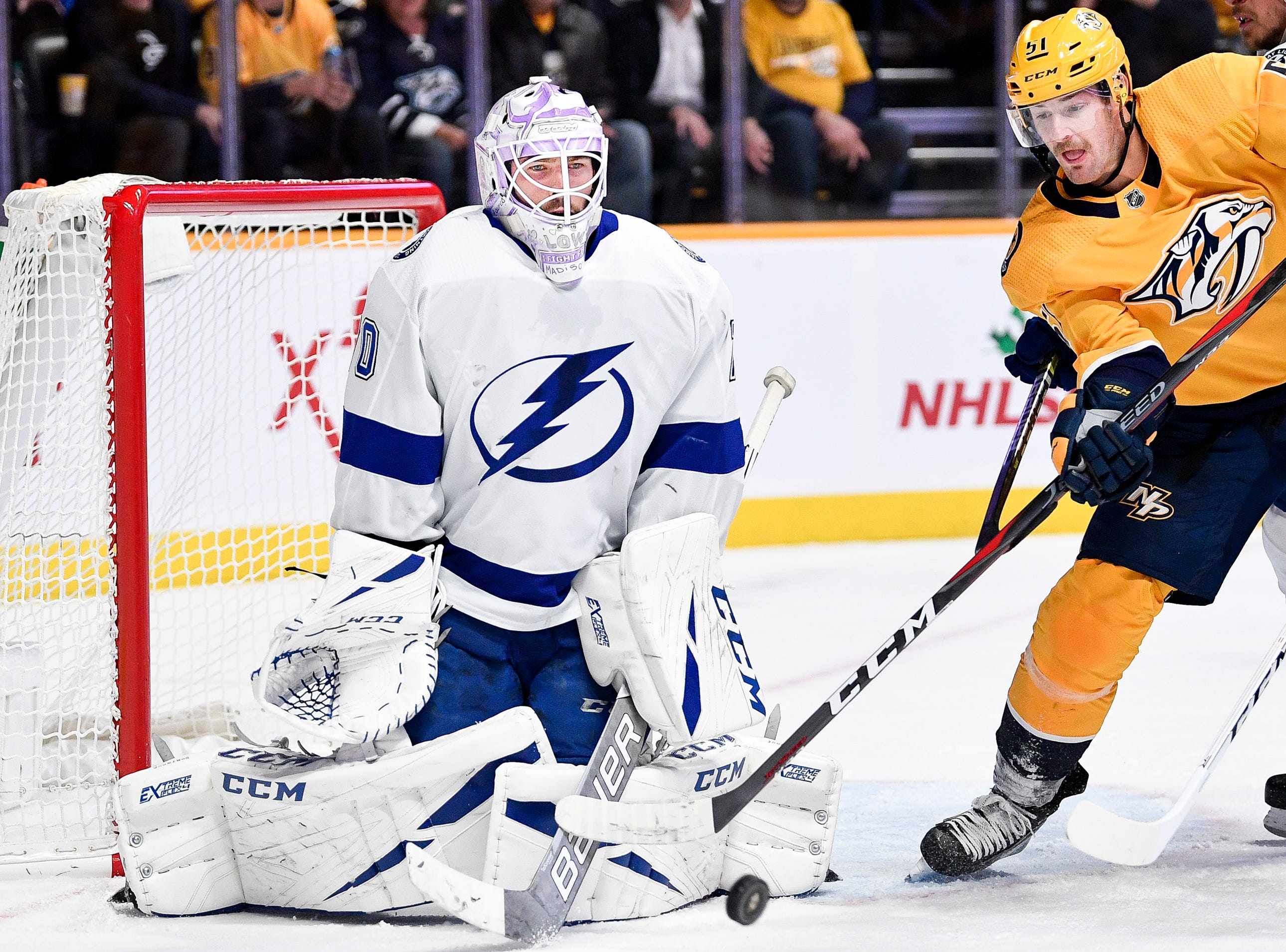 Tampa Bay Lightning goaltender Louis Domingue (70) battles Nashville Predators left wing Austin Watson (51) during the first period at Bridgestone Arena in Nashville, Tenn., Monday, Nov. 19, 2018.