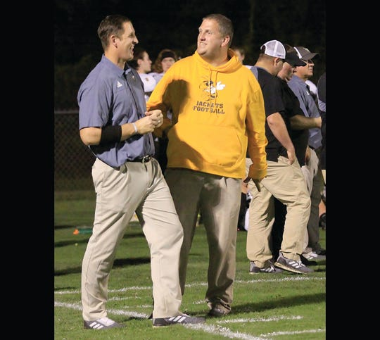 Micheal Jackson and his brother Joey Jackson enjoy a moment on the sidelines. Both men helped coach the FHS Yellow Jacket football team for the 2018 season.