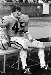 Vanderbilt linebacker Chip Healy takes a break while the offense faces Tulane on Nov. 2, 1968. The Commodores used a strong running game to roll past Tulane 21-7 before a homecoming crowd of 16,469.