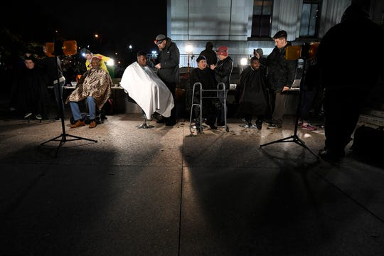 Nashville Street Barbers cut hair for the homeless at War Memorial Plaza Monday, Nov. 19, 2018, in Nashville, Tenn.