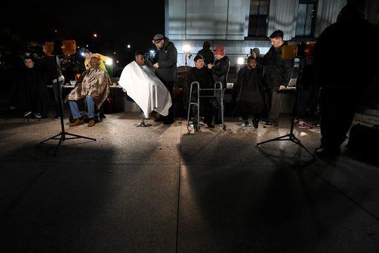 Nashville Street Barbers cut hair for the homeless at War Memorial Plaza Monday, Nov. 19, 2018, in Nashville, Tenn.