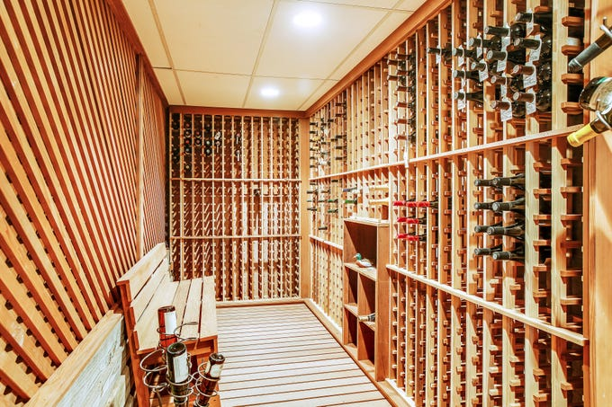 A dedicated wine room in this home for sale in Tullahoma is a great spot to display special bottles of wine or a terrific storage option says Megan Jones, LCT Team – Parks.