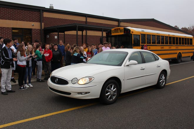 Westmoreland High School custodian Penny Calvert drove her new car to students' delight. Students and faculty raised money to buy the car for Calvert.