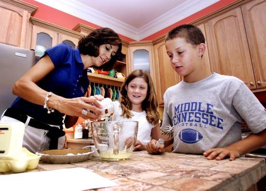 DNJ photo by Rachelle MorvantSara, Emily, 9, and Brent Stockstill, 12, use teamwork to make a Margarita Pie Wednesday at the Stockstill residence.