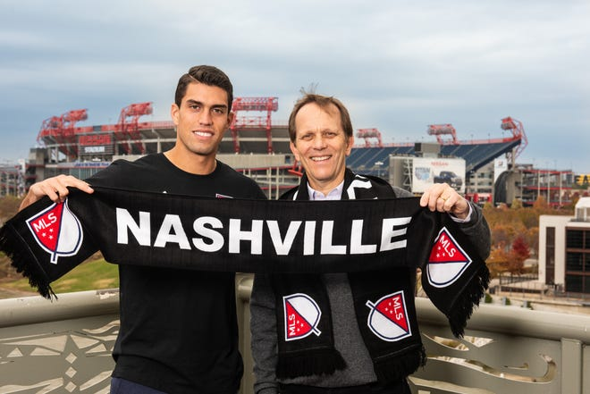 Daniel Ríos, the first player signed by Nashville's MLS team, with team owner John Ingram outside of Nissan Stadium.