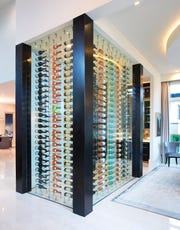This Castle Homes wine room turns wine into art. The bottles are color coordinated.