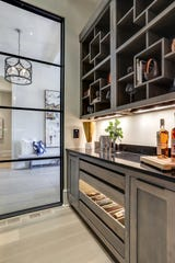 This home built for the Witherspoon Parade of Homes by Legend Homes included a wine room with beautiful windows and plenty of display space.