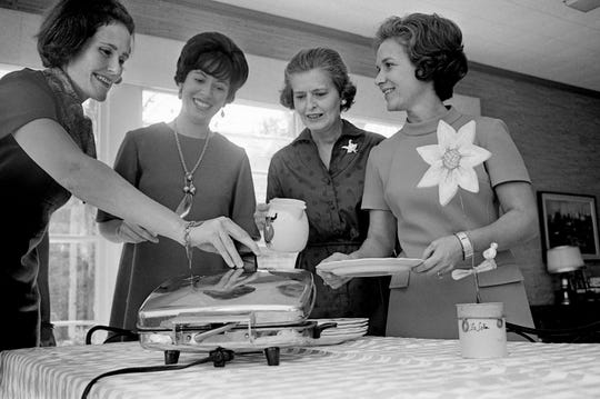 Mrs. Ridley Wills II, left, Mrs. J.L. Thompson III, Mrs. John M. Harwood Jr. and Mrs. John K. Maddin Jr. gather at the Downtown Presbyterian Church on Nov. 18, 1968. The four will help serve at the church's annual Waffle Shop on Dec. 4.