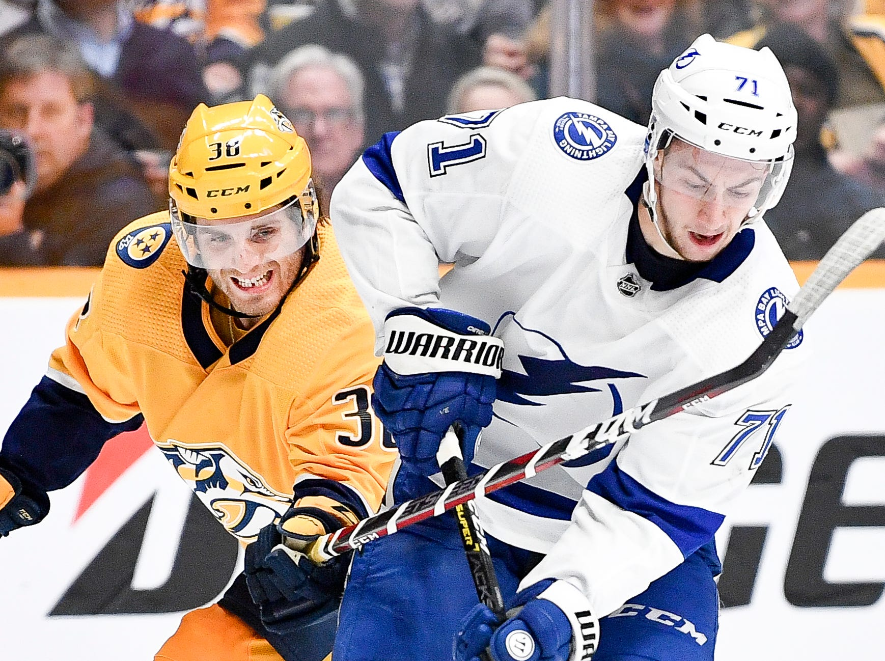 Nashville Predators right wing Ryan Hartman (38) battles with Tampa Bay Lightning center Anthony Cirelli (71) during the second period at Bridgestone Arena in Nashville, Tenn., Monday, Nov. 19, 2018.