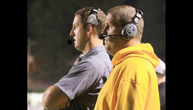 Michael Jackson and his brother Joey Jackson on the sidelines coaching the FHS Yellow Jackets.