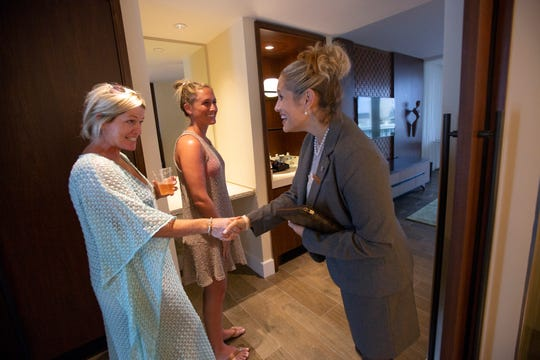 Nancy Moore, left, and her daughter Jennifer Moore are greeted by Amanda Cox, director of sales and marketing at JW Marriott Marco Island Beach Resort, before touring a suite at the resort's new Lanai Tower on Tuesday, Nov. 20, 2018.