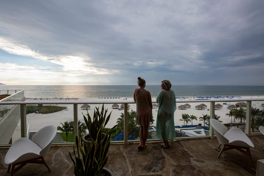 Jennifer Moore, left, and her mother, Nancy Moore, both from Boston, take in the beach view at the the bar at Tesoro, inside the adult-exclusive Lanai Tower at JW Marriott Marco Island Beach Resort on Tuesday, Nov. 20, 2018.