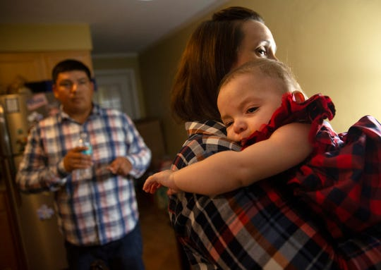 Victor and Annie Torres get their daughter, Lucia, ready for a family trip Monday, Nov. 19, 2018, at their home in Naples Park.