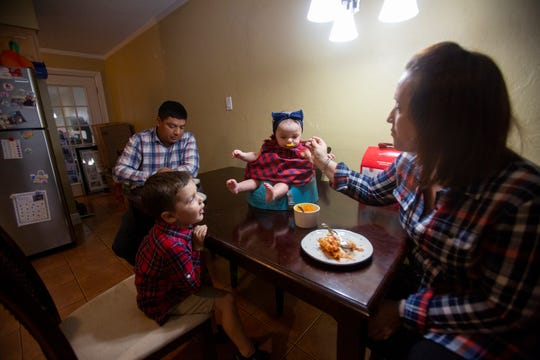 The Torres family, clockwise from left, father Victor, daughter Lucia, mother Annie and their son Rocco, enjoy dinner together at their home Monday, Nov. 19, 2018, in Naples Park.