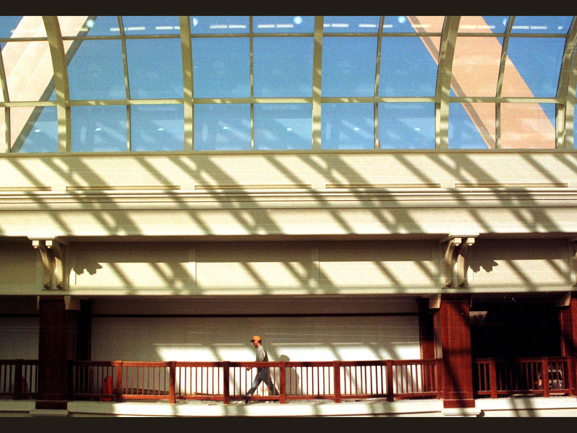An employee walks beneath the skylight inside the Longaberger Basket Building in February of 1998.