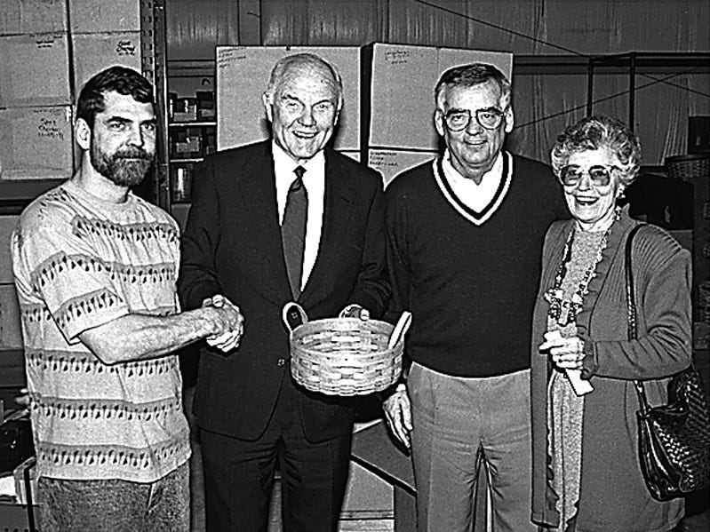 John and Annie Glenn receiver a Longaberger basket from Dave.