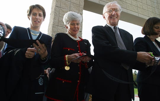 Gib Reese, right, his wife, Lou, and daughter Sarah Reese Wallace, left, cut the ribbon at the opening of the Reese Center on the Newark Campus of Ohio State University and Central Ohio Technical College in 2003. (Submitted photo.)