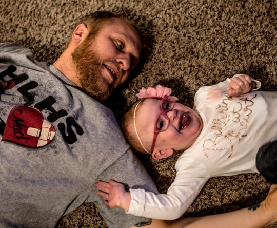 Maci Whisner and her dad Josh play on the floor of their Heath Home. Maci who is now two years old has defied the odds. She was born with a heart condition and was placed on hospice are at 1 day old.  After two open heart surgeries, five interventional cardiac catheterizations and many ups and downs, Maci is beginning to live as a regular two year old.