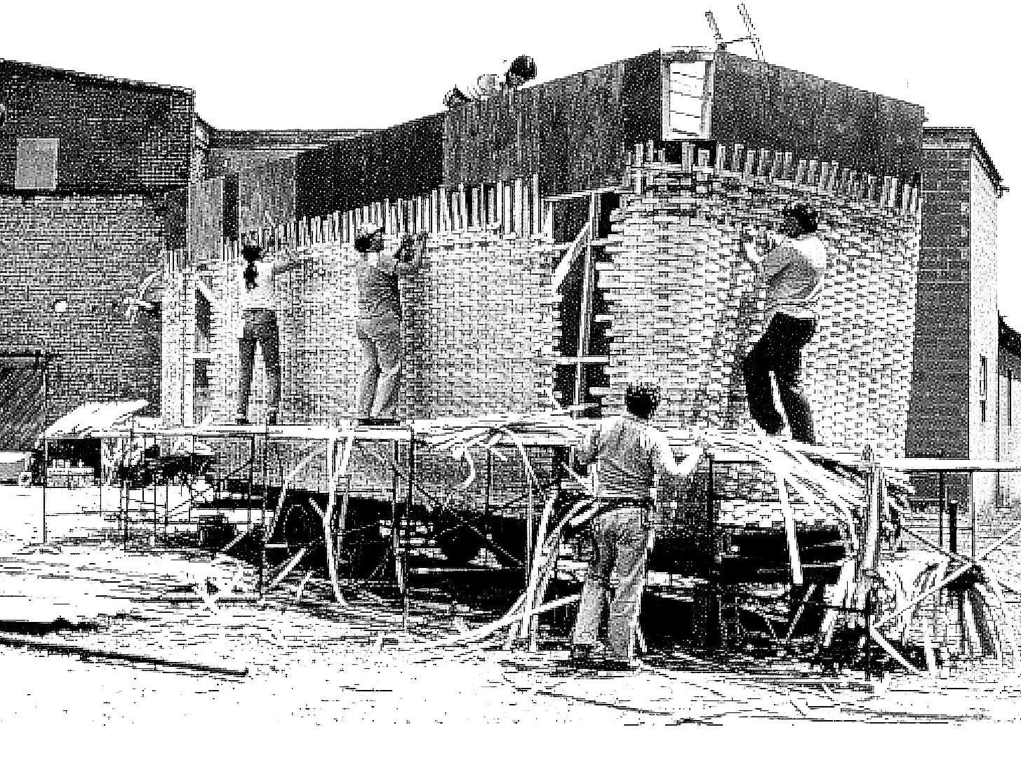 Weavers in Dresden work on a larger than average Longaberger basket.