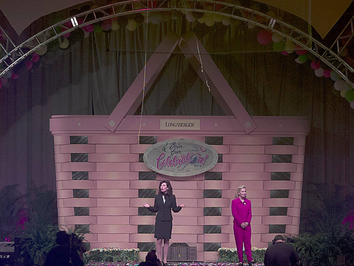 Dave Longaberger's daughters Tami and Rachel on stage during the 1998 Longaberger Bee.