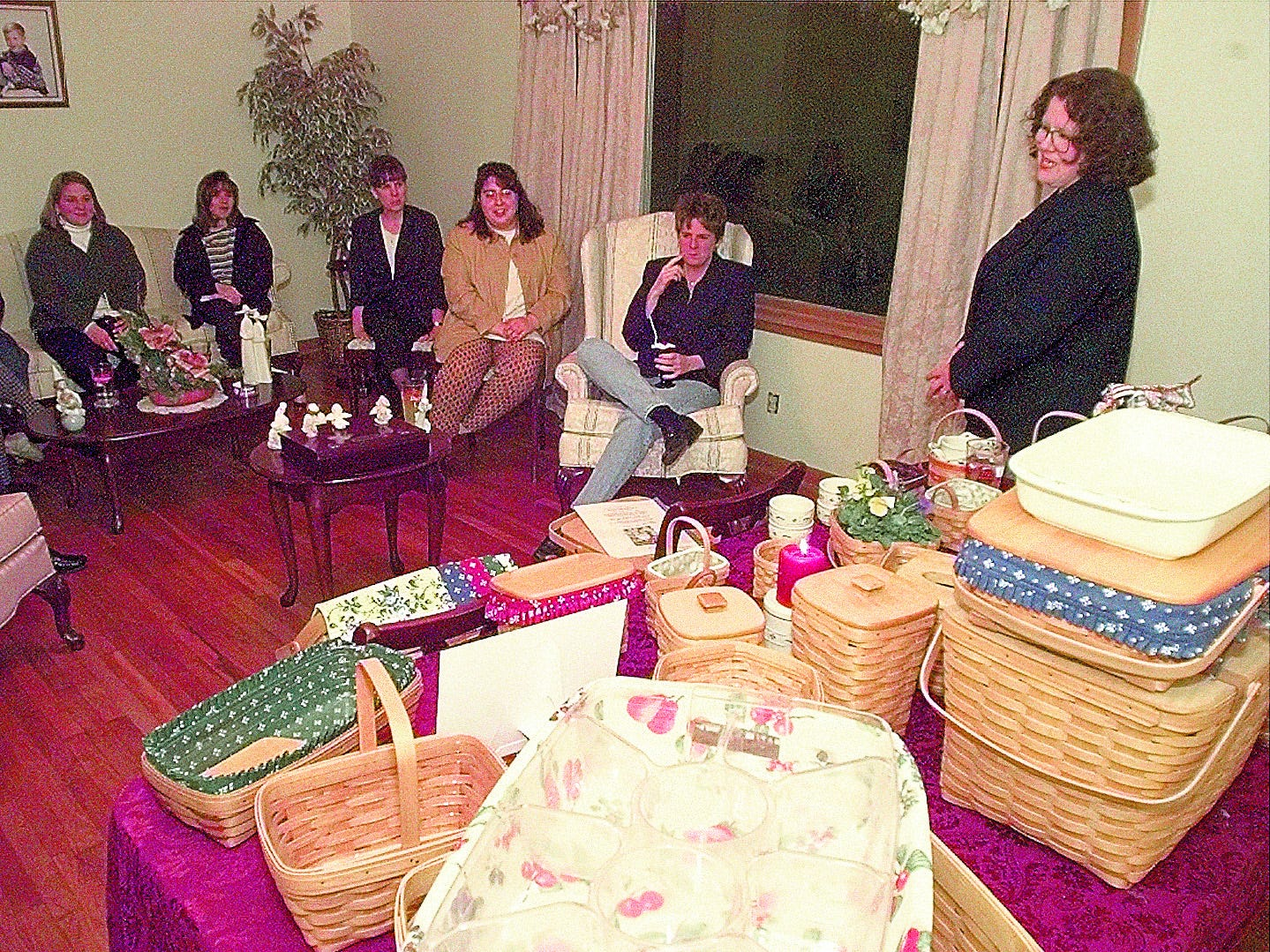 Chris Powers (right) discusses the variety of baskets available from Longaberger during a home show in 1999.