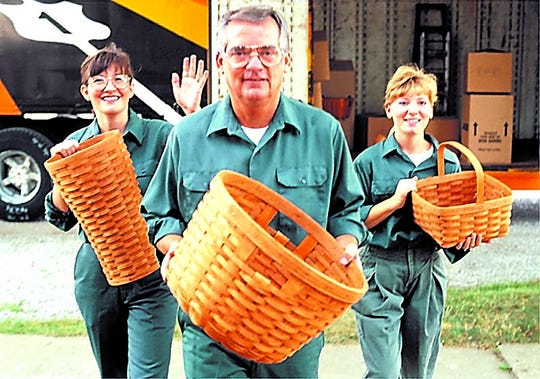 Dave Longaberger with daughters Tami and Rachel and three of the company's beloved baskets.