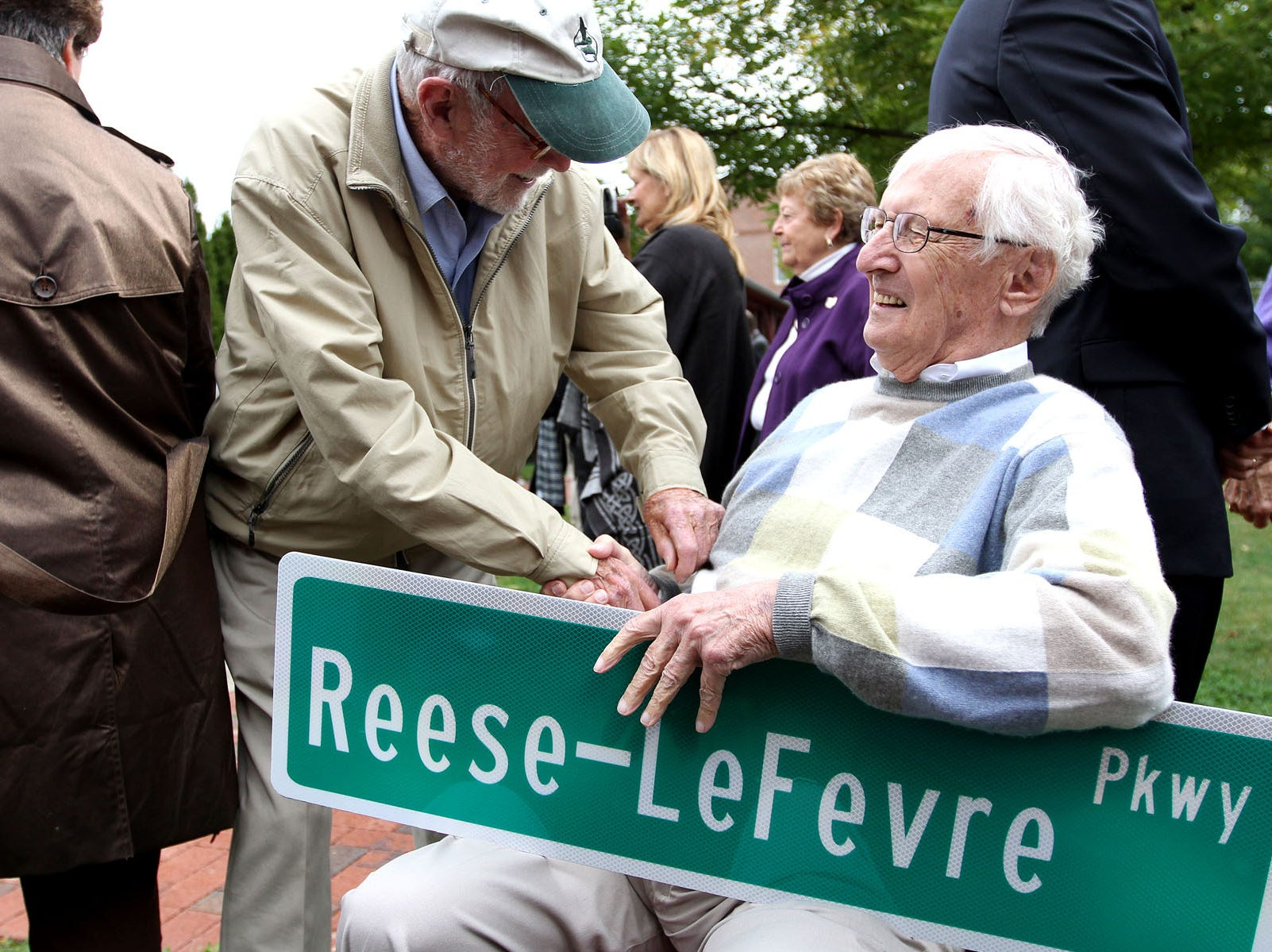 Jack O'Neill, left, comes up to shake the hand of Gib Reese at a dedication of the newly named Reese-LeFevre Parkway, in honor of J. Gilbert Reese and Howard E. LeFevre at The Works in Newark, Ohio on Saturday, Sept. 24, 2011. Zach Gray/The Advocate