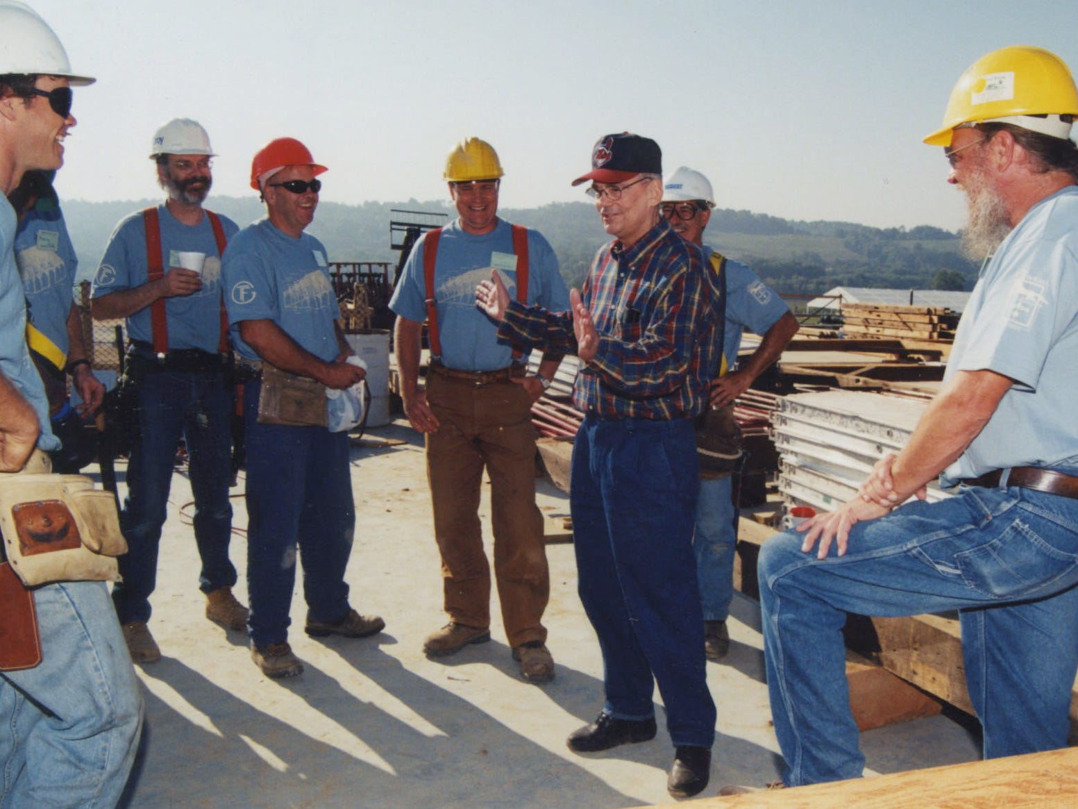 Dave Longaberger talks with construction workers at one of the many Longaberger buildings.