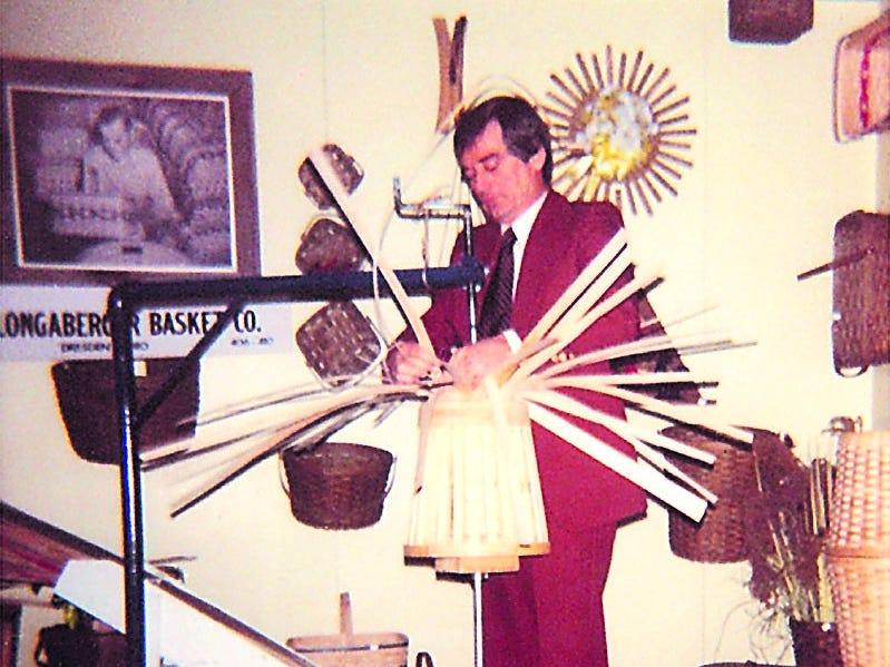 Dave Longaberger weaves a basket.