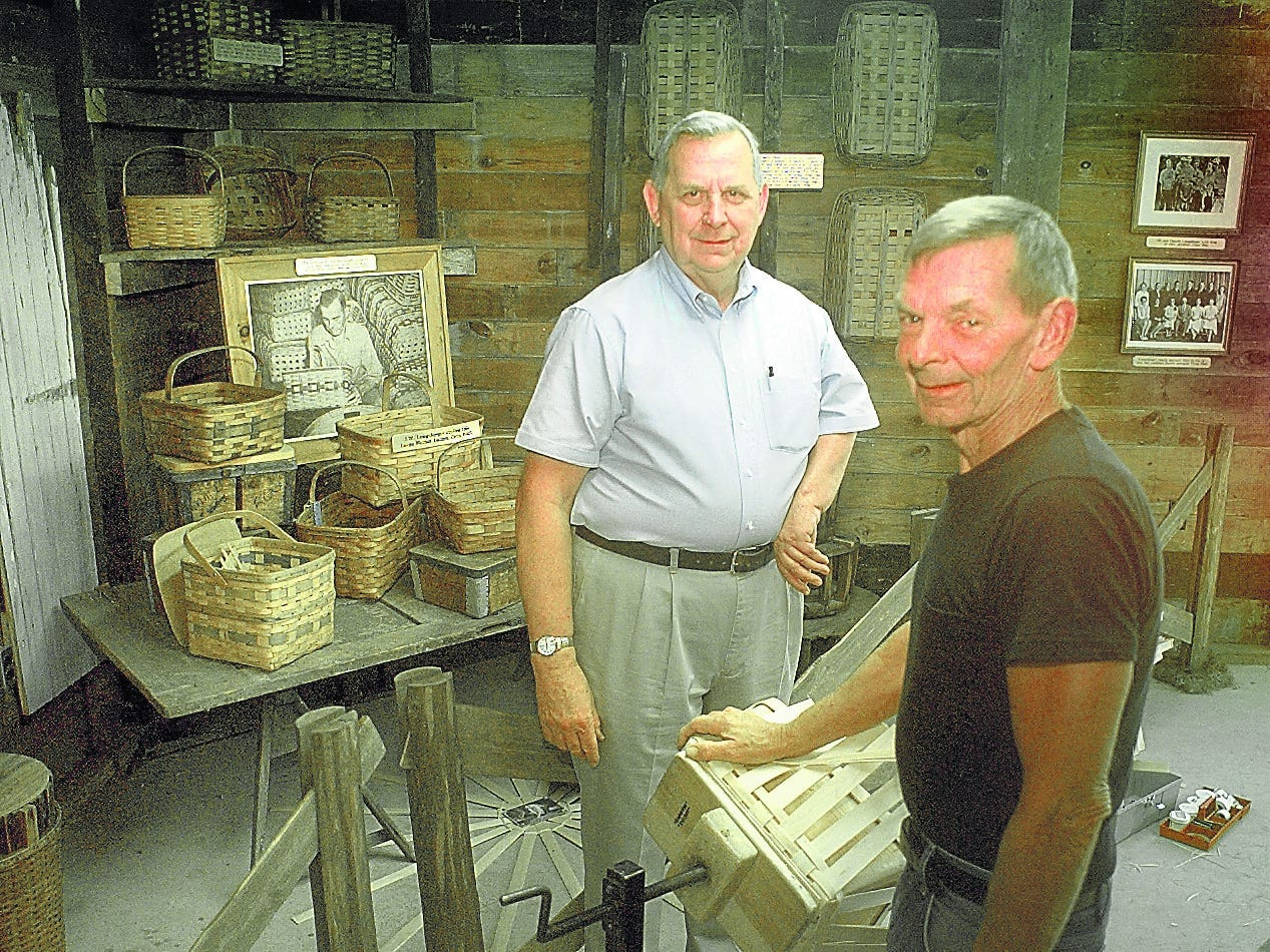 Larry, left, and Jerry Longaberger at their father's original basket weaving shop, now located at the Longaberger Homestead.