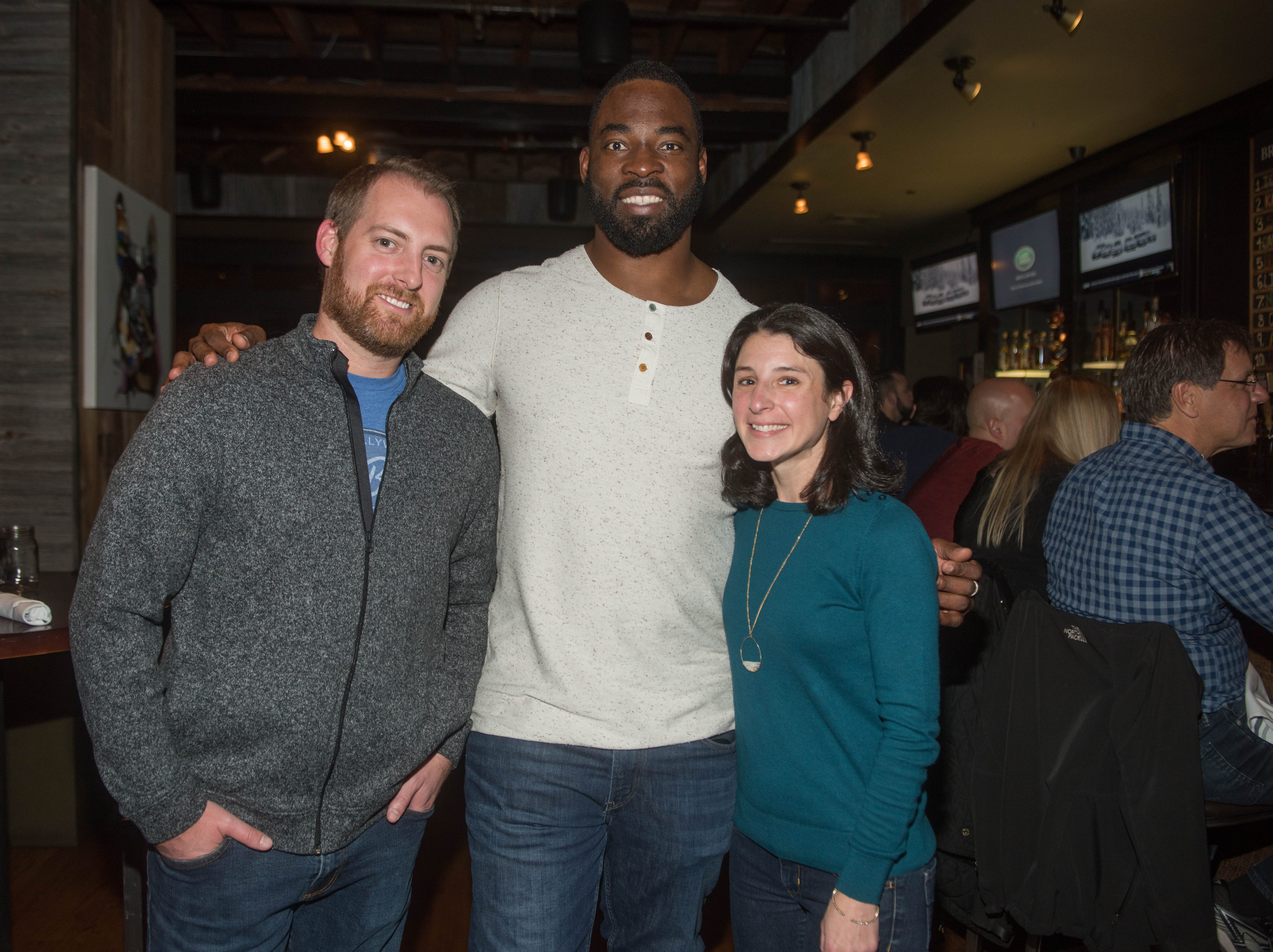 Erik Stainsen, Justin Tuck and Laura Adams Stainsen. (201) Magazine and NorthJersey.com held Taste Test Tuesday at he Dog and Cask in Rochelle Park with this month's cover model, Lauran Tuck and former cover model and former NY Giant Justin Tuck. 11/13/2018