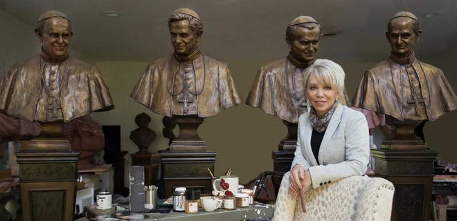 Saddle River sculptor Carolyn Palmer with her castings of Popes Francis, Benedict XVI, John Paul II and Paul VI for St. Patrick's Cathedral in Manhattan.
