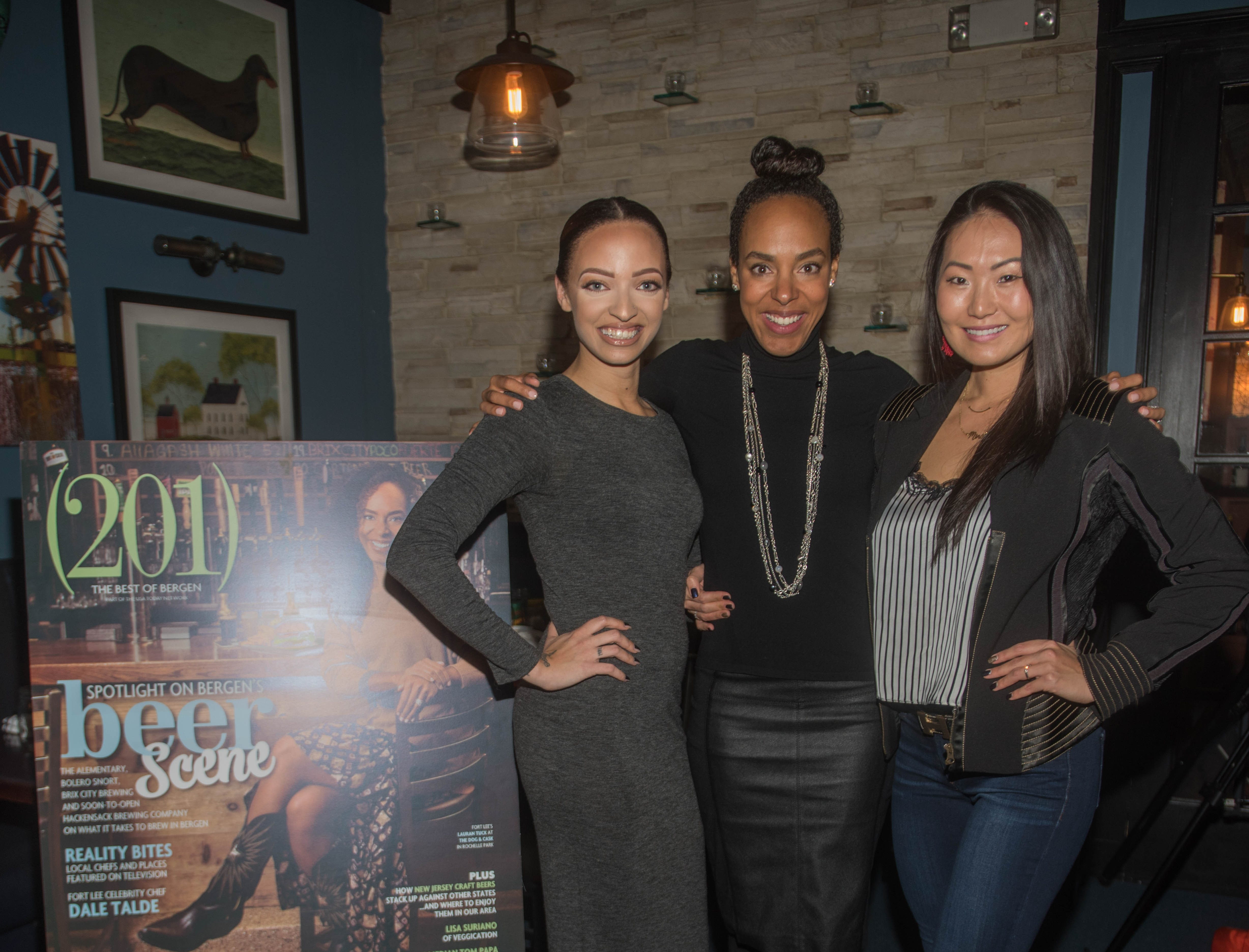 April Lucious, Lauran Tuck and Mina Barany. (201) Magazine and NorthJersey.com held Taste Test Tuesday at he Dog and Cask in Rochelle Park with this month's cover model, Lauran Tuck and former cover model and former NY Giant Justin Tuck. 11/13/2018