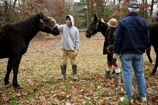 Kevin Bombace, 22 of Ridgewood, joined the Marines after graduating from high school. His military career was cut short after discovering he had leukemia. Since volunteering with the Unbridled Heroes Project, helping to clean the horse ring and bonding with the horses, Bombace has found a new purpose in each day.