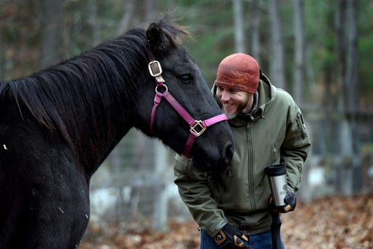 Veteran Mark Steppe, founder of The Unbridled Heroes Project in Allendale bonds with a wild American mustang on Rohsler's Allendale Nursery. Steppe and his wife veteran Amy Steppe of Ridgewood founded the program, hoping to save both wild American Mustangs and returning veterans.