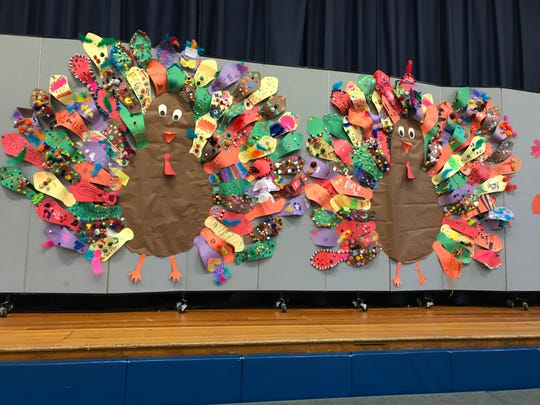 Construction paper turkeys with each feather made by a different student at Hillside Elementary School in Closter, part of their annual Thanksgiving Show.
