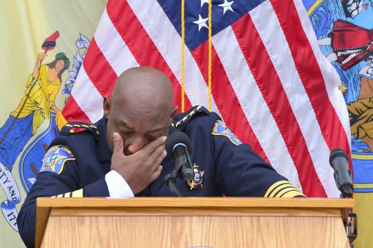 Wiping tears from his eyes, Anthony Cureton, Bergen County Sheriff, gives his speech on the front steps of the Bergen County Courthouse in Hackensack on Tuesday morning November 20, 2018.