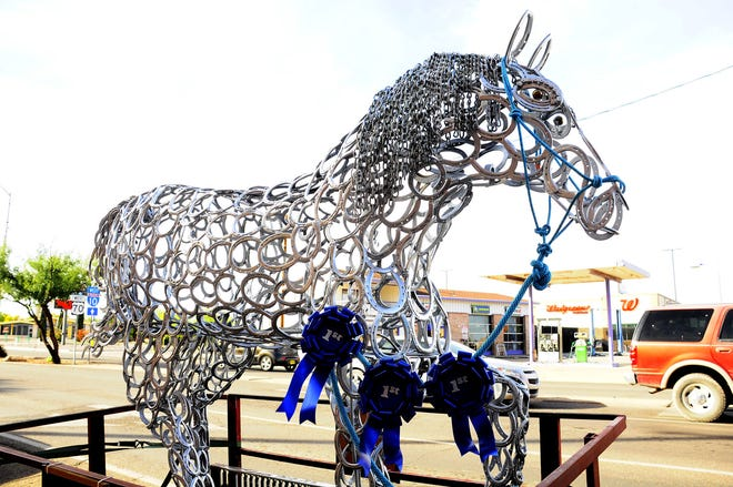 """Oscar Earl's """"Silver"""" entry was the """"Best of Show"""" and """"Peoples' Choice"""" award winner during the Keep Luna County Beautiful Recycled Art Show at the Deming Art Center."""