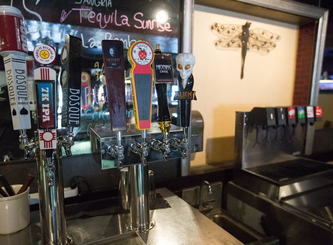 Downtown Las Cruces restaurant Dragonfly has a selection of New Mexico beers on tap Tuesday Nov. 20, 2018.  Carin Kelly, one of Dragonfly's owners, said she felt proposed legislation allowing some restaurants with beer and wine licenses to also sell New Mexico-produced hard liquor would help put Dragonfly on a level playing field.
