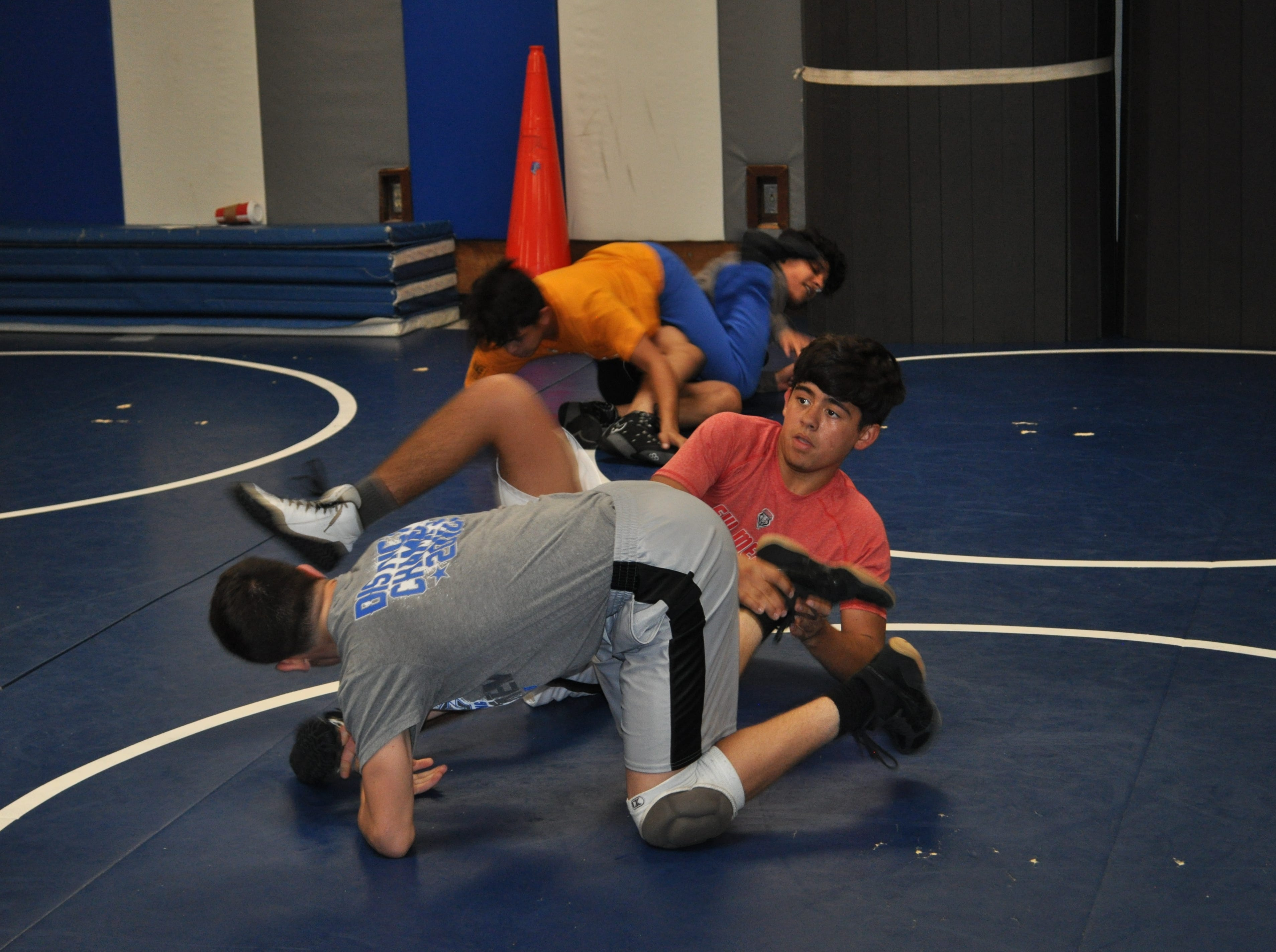 Carlsbad wrestlers get in mat work during Tuesday's practice. Carlsbad finished second in the 6A state tournament last year and looks to claim the title this season.