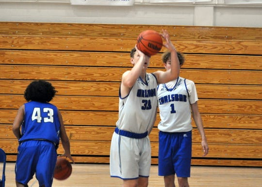 Ayden Parent (33) gets off a shot while Josh Sillas (1) looks on during Tuesday's practice.