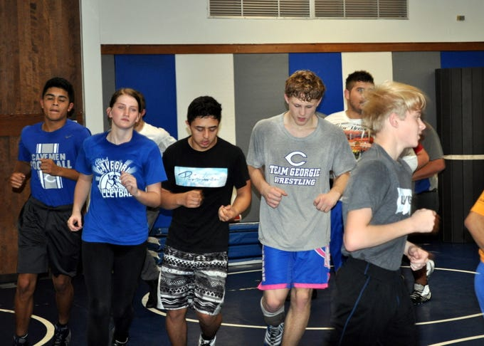 Carlsbad wrestlers jog as part of a cooldown during Tuesday's practice. Carlsbad finished second in the 6A state tournament last year and looks to claim the title this season.