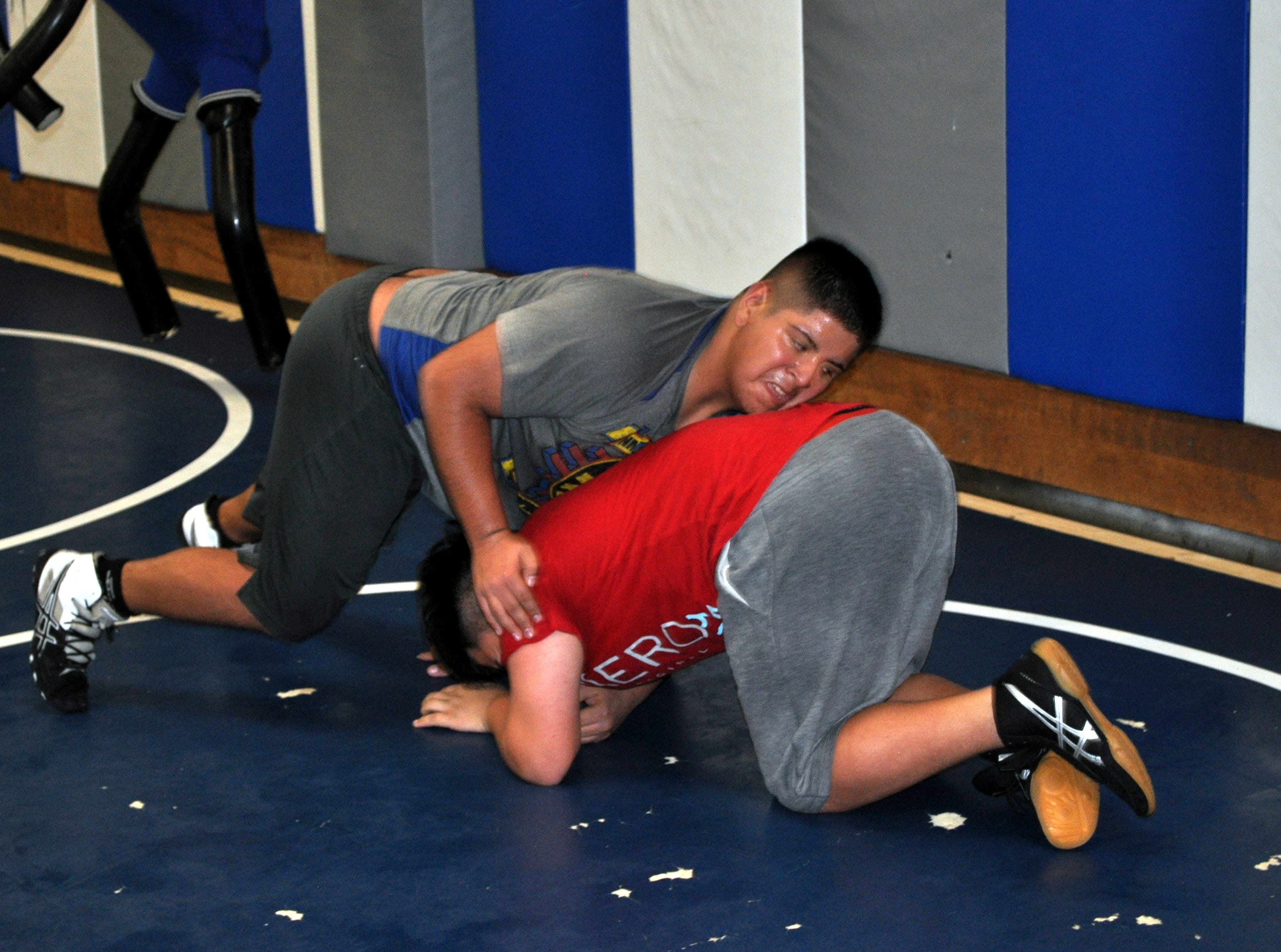 Andrez Sapien gets in mat work during Tuesday's practice.