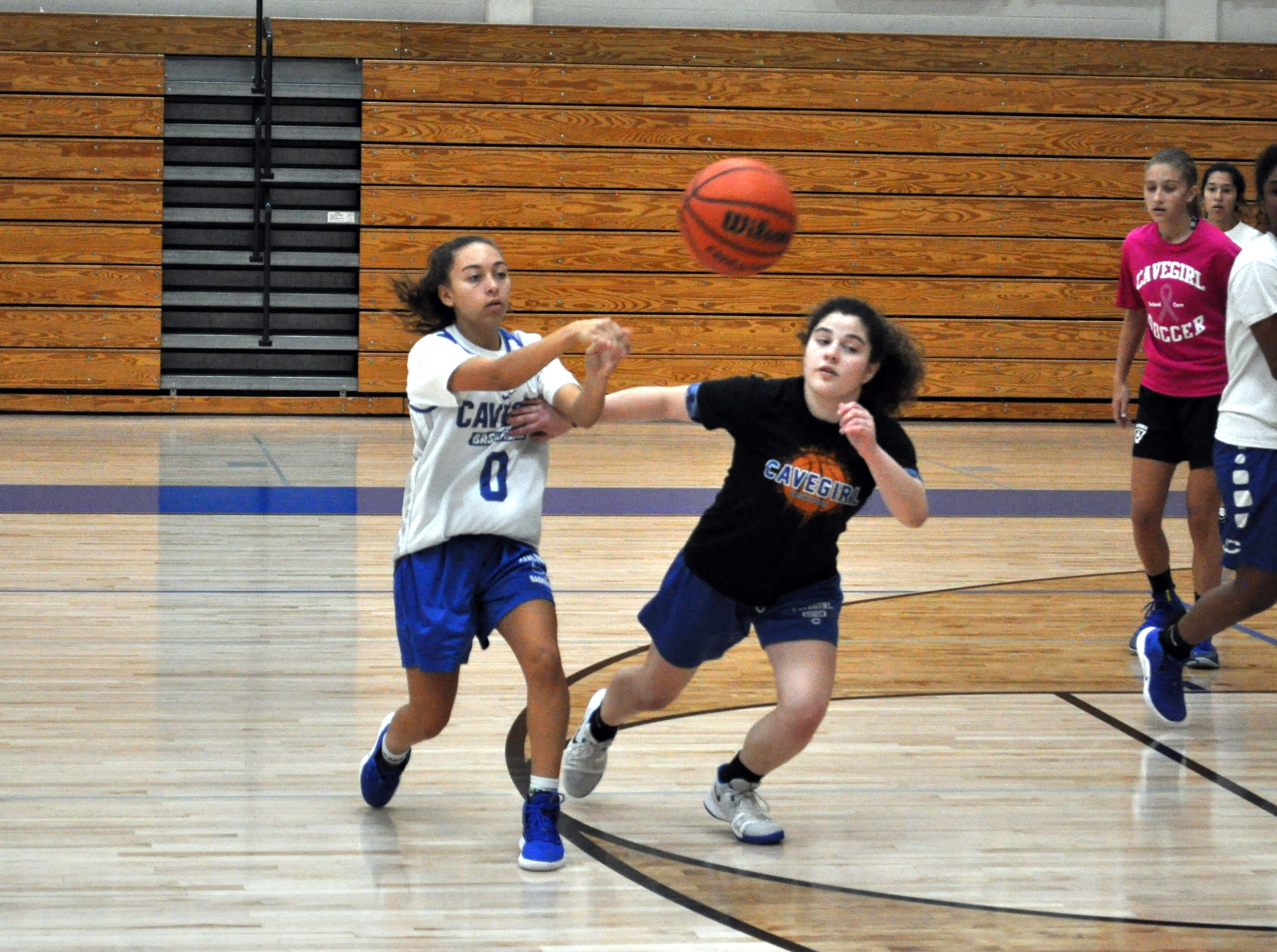 Carlsbad junior Baylee Molina passes during Tuesday's practice.