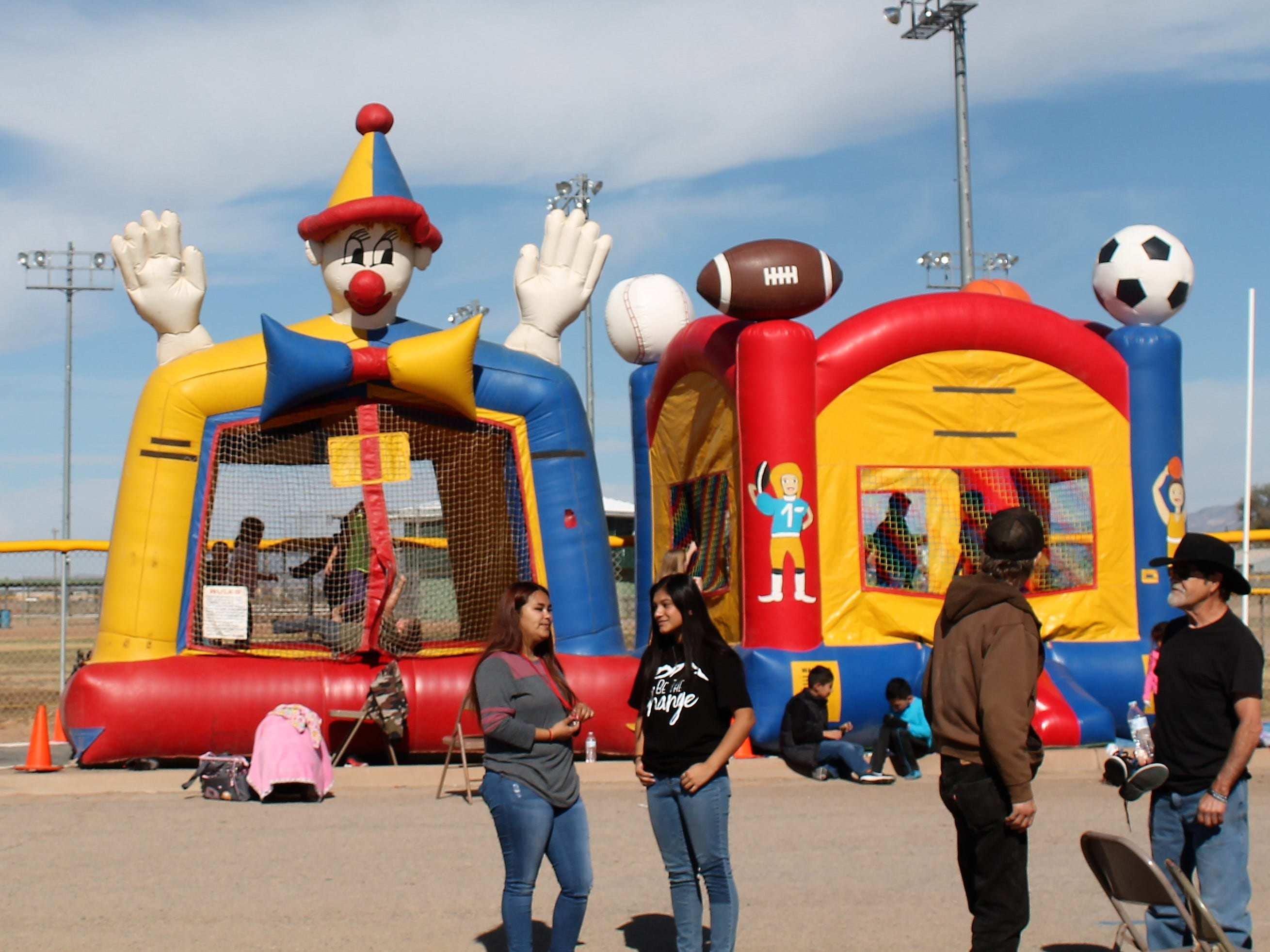 Children play in bounce houses at the Mountain View Assembly of God Thanksgiving Outreach Tuesday at the Travis C. Hooser Ballfield Complex on Walker Avenue.
