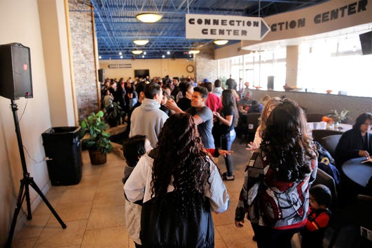 The line grows for a Thanksgiving meal served Tuesday afternoon at Oasis Church in Farmington. The San Juan County Juvenile Serivces, Desert View Family Counseling and Cottonwood Clinical Services hosted the meal.