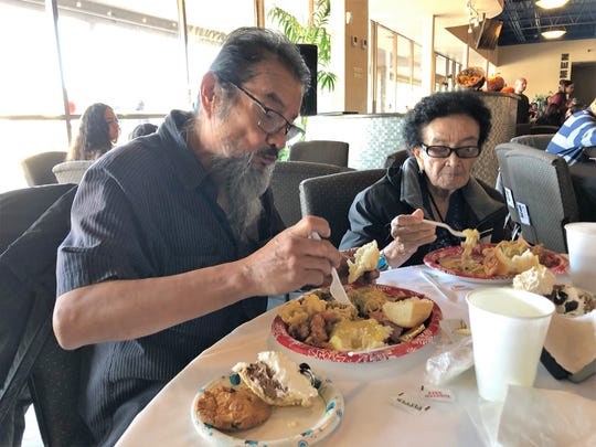 Norman Benally, left, and Betty Mason, right, eat a Thanksgiving meal Tuesday afternoon at Oasis Church in Farmington. The San Juan County Juvenile Services, Desert View Family Counseling and Cottonwood Clinical Services hosted the meal.