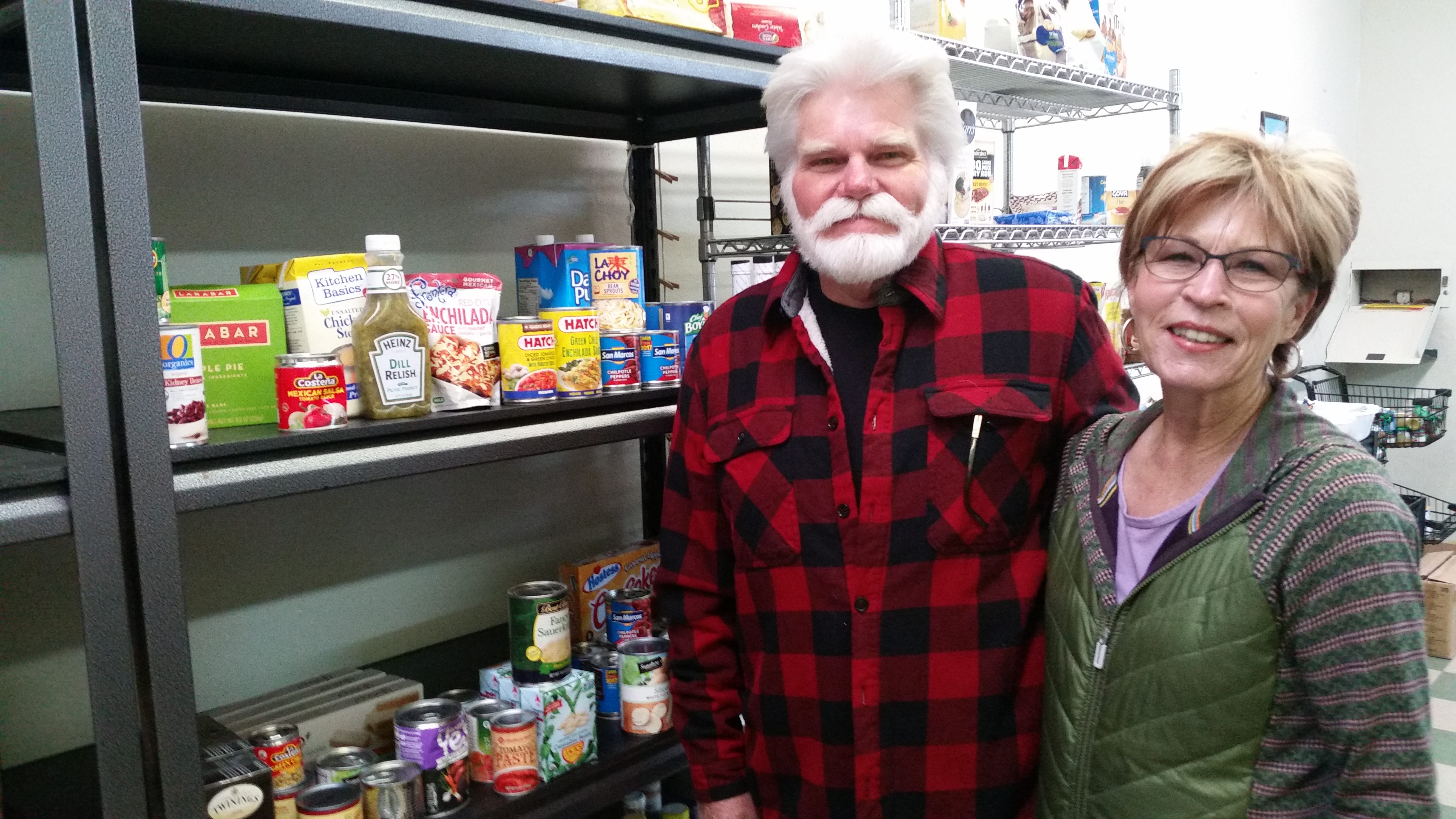 Jamie Estes and Joy Hughes are volunteers at the Lincoln County Food Bank.