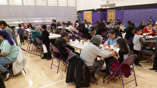 Elders from The Mescalero Apache Tribe make arts And crafts and were joined by some of their grandchildren.